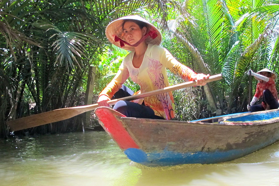 A woman in a boat in Vietnam