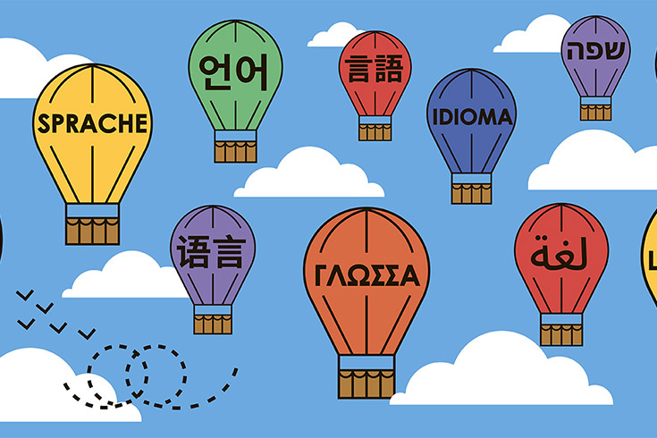 illustration of hot-air balloons aloft, each branded with a different language