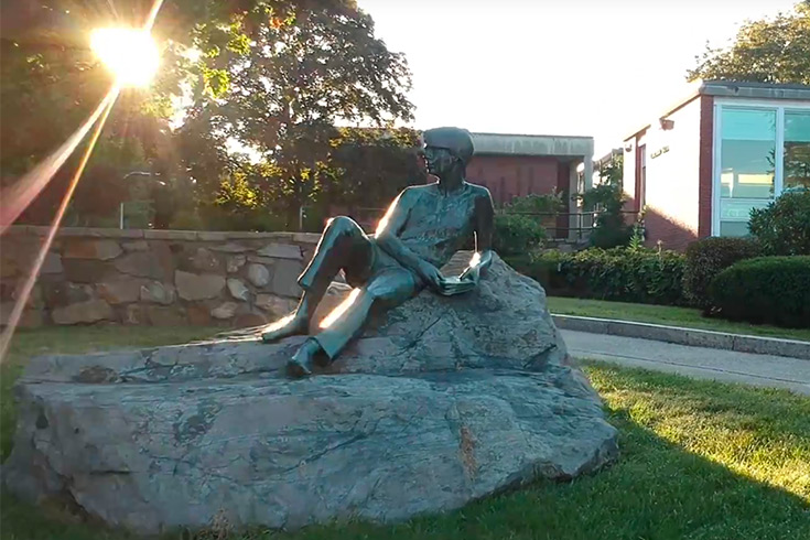 A statue in front of the Brandeis Libraries