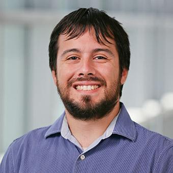 Ian smiling on grey background