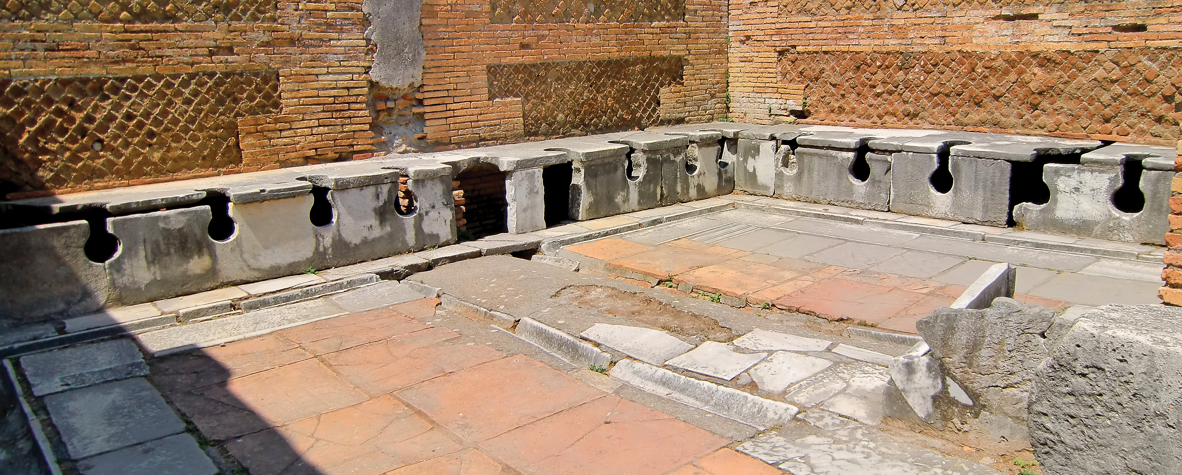 Remnants Of A Public Latrine Built In Ostia