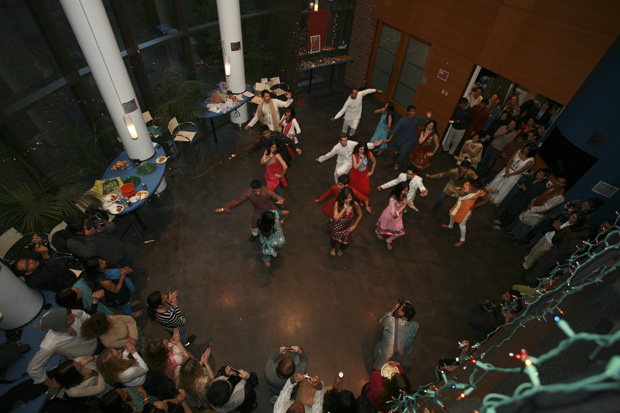 Students perform a traditional South Asian dance in the World Court of the Brandeis International Business School