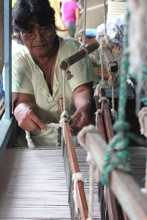 A back strap loom in action