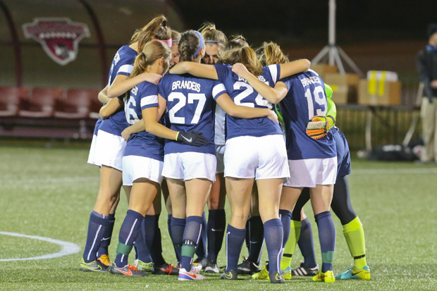 Brandeis' 2016 womens' soccer team huddles