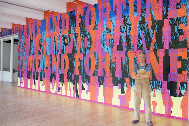 Joe Wardwell in front of his 144 foot long mural at MASS MoCA.