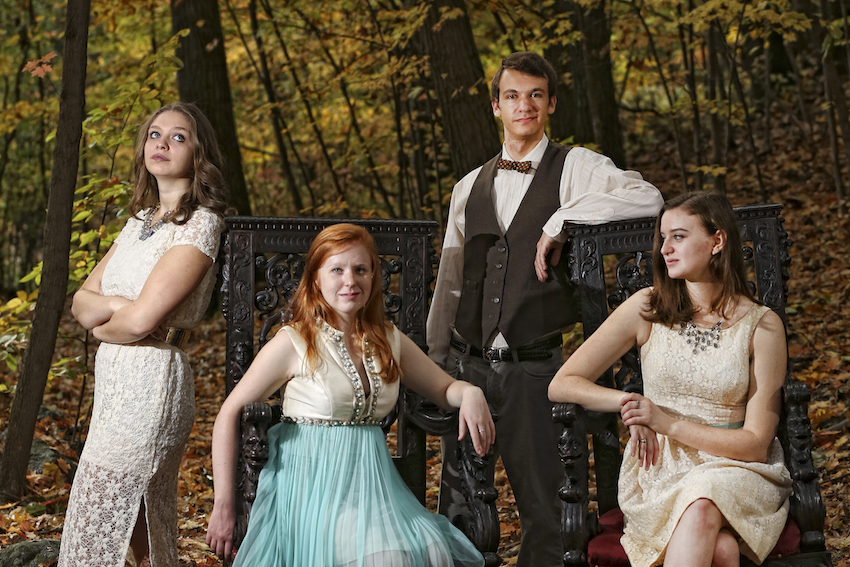 Theater arts students strike a pose in the woods