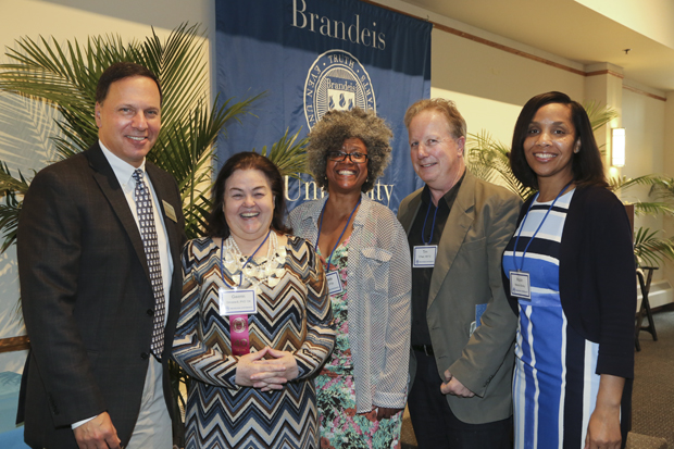 From Left to right: Brandeis President Ron Liebowitz,, Gwenn Smaxwill PhD '04, Taneeta Bacon P '06, Tim O'Neil, vice president of human resources Robin Nelson Bailey