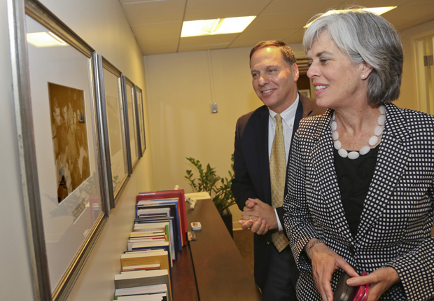 Brandeis President Ron Liebowitz and Congresswoman Katherine Clark look at a photo of Eleanor Roosevelt at Brandeis.