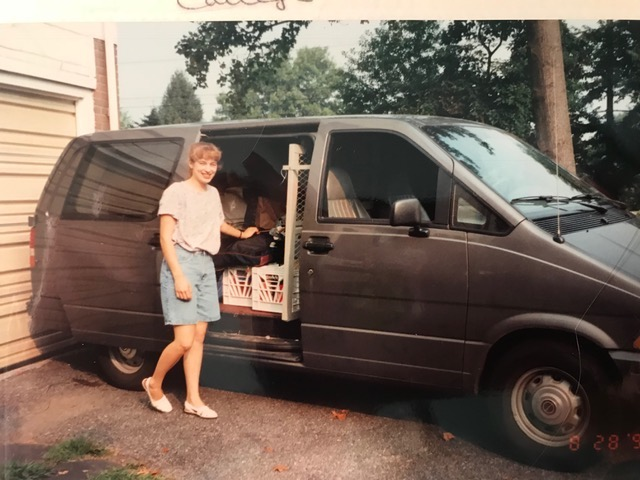 Wendy Cadge pulling boxes from an old minivan
