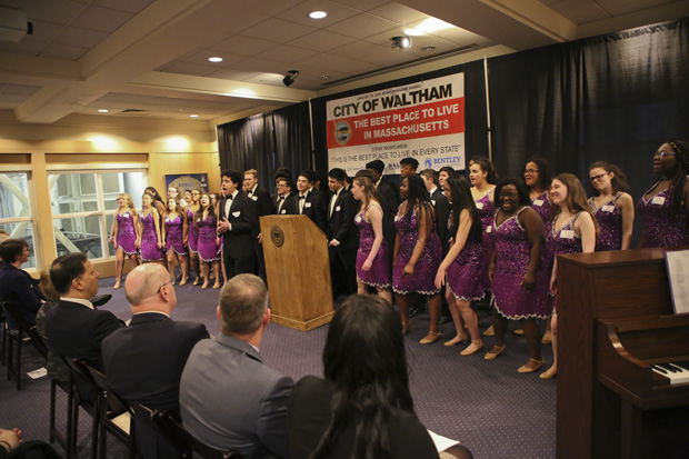 Waltham High School choir Music Unlimited performs for the audience