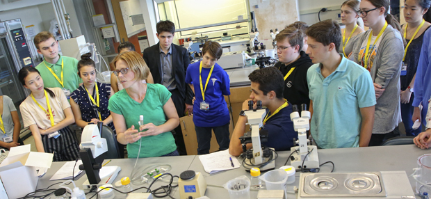 Students at the 2018 Global Youth Summit on the Future of medicine in the lab with Melissa Kosinski-Collins, professor of Biology