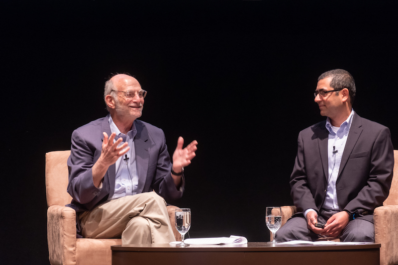 Michael Rosbash and Vipin Suri, PhD'01, on stage.