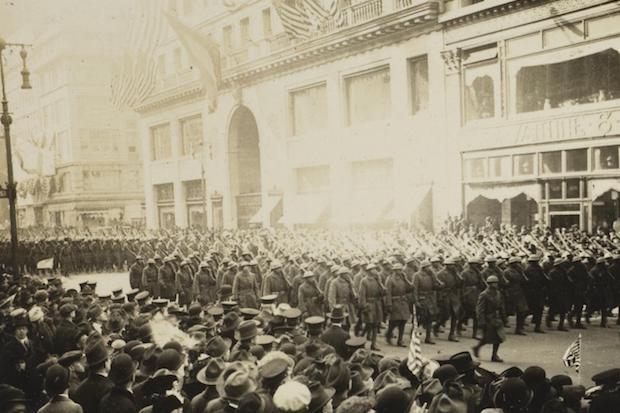 369th infantry marches up fifth avenue in a victory parade in 1919.