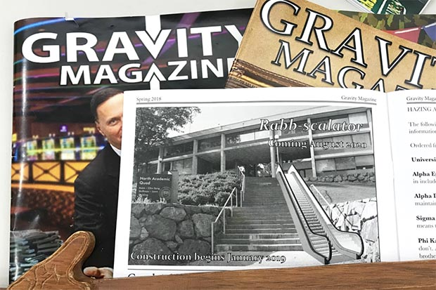 A pile of past editions of the Gravity magazine.