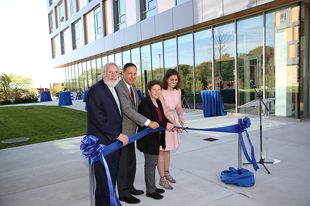Meyer Koplow, Ron Liebowitz, Jeannette McCarthy and Hannah Brown cut a ribbon