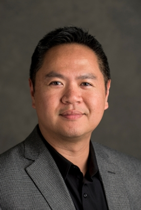 vertical headshot of vice provost of student affairs Raymond Ou