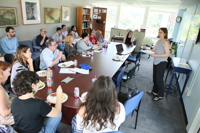 Attendees watch Wendy Cadge speak at Summer Lab event