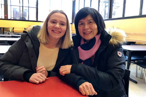 Jordan Loranger '19 with sitting at a table in Sherman with staff member Ling Sze, who she tutors in English