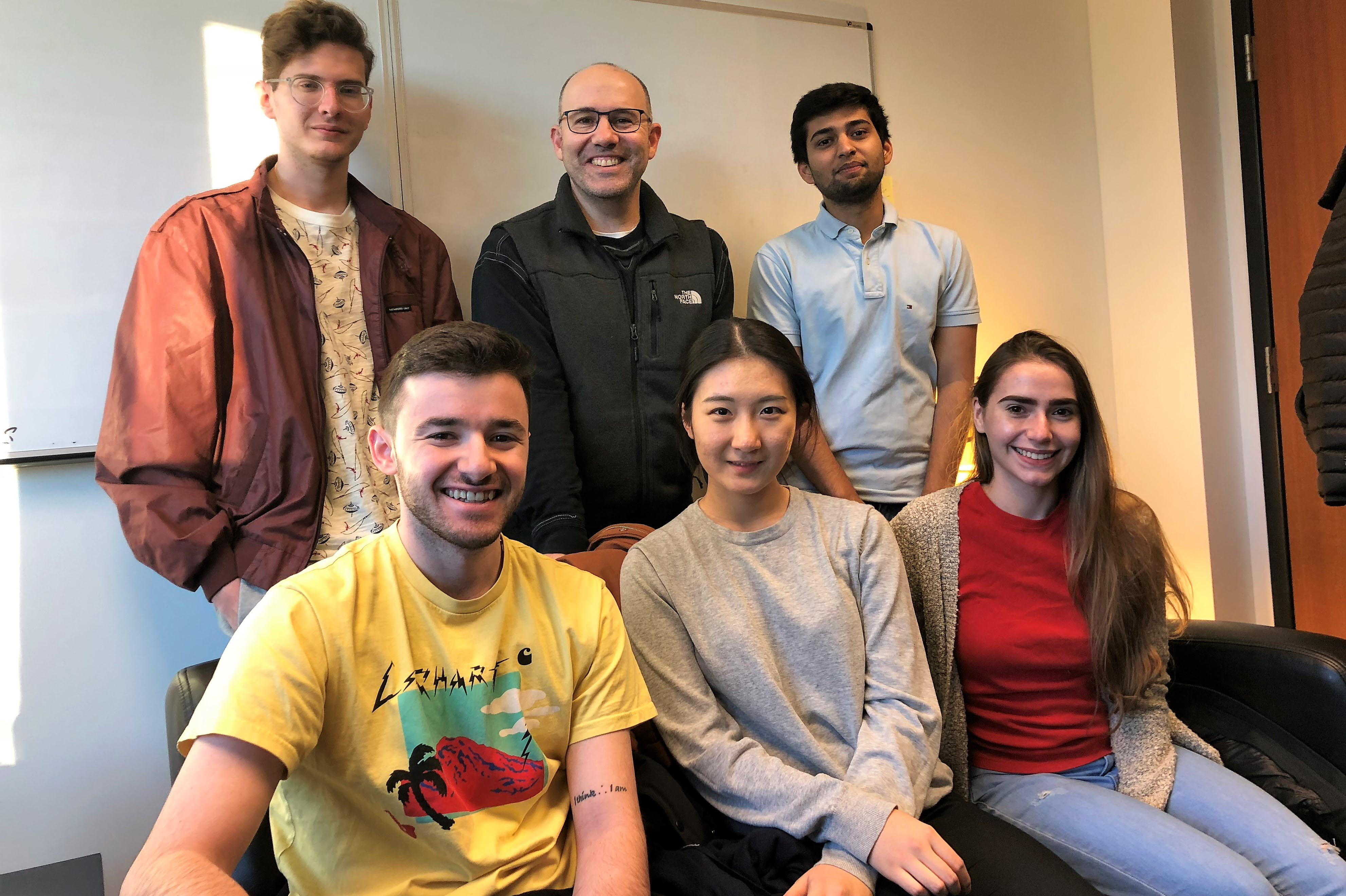 Professor Andy Molinsky with members of his student podcast team, including Kevin Dikdan '20, Manas Maniar '19,Jordan Brodie '19, Yuechen Ta '21 and Ali Carney '19.