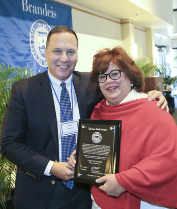 President Ron Liebowitz with Judy Salvucci, who works in the Office of the Provost and received the Lou Ennis Staff Award