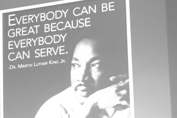 Martin Luther King Jr. with a quote about community service