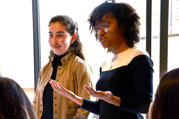 Madeline Bisgyer '20 and Noaem Shurin '19, speak to a group in front of a window
