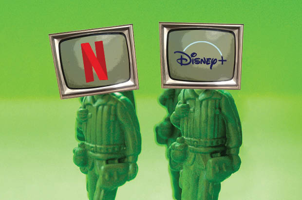 two toy soldiers wearing television screens with logos of streaming services