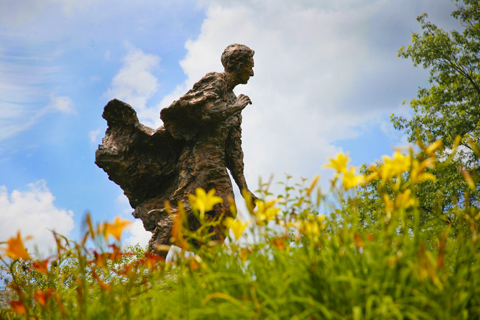 Louis Brandeis statue in summer with flowers in foreground