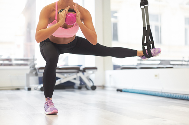 an instructor leading a barre class