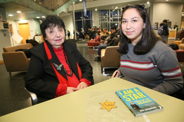 Inge Auervacher seated at a table in the Shapiro Student Center with Mutiara Carney '22