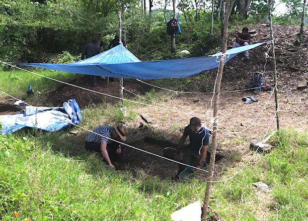 Workers excavate the archaeological site