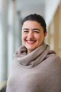Head shot of  Professor Naghmeh Sohrabi in a cowl-neck sweater