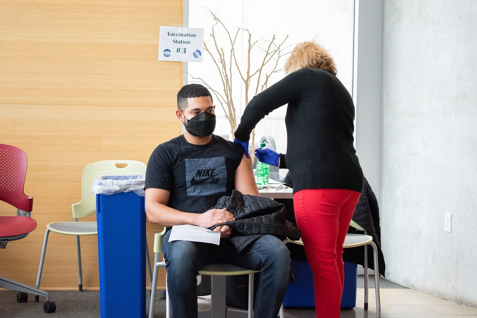 student receives a vaccine