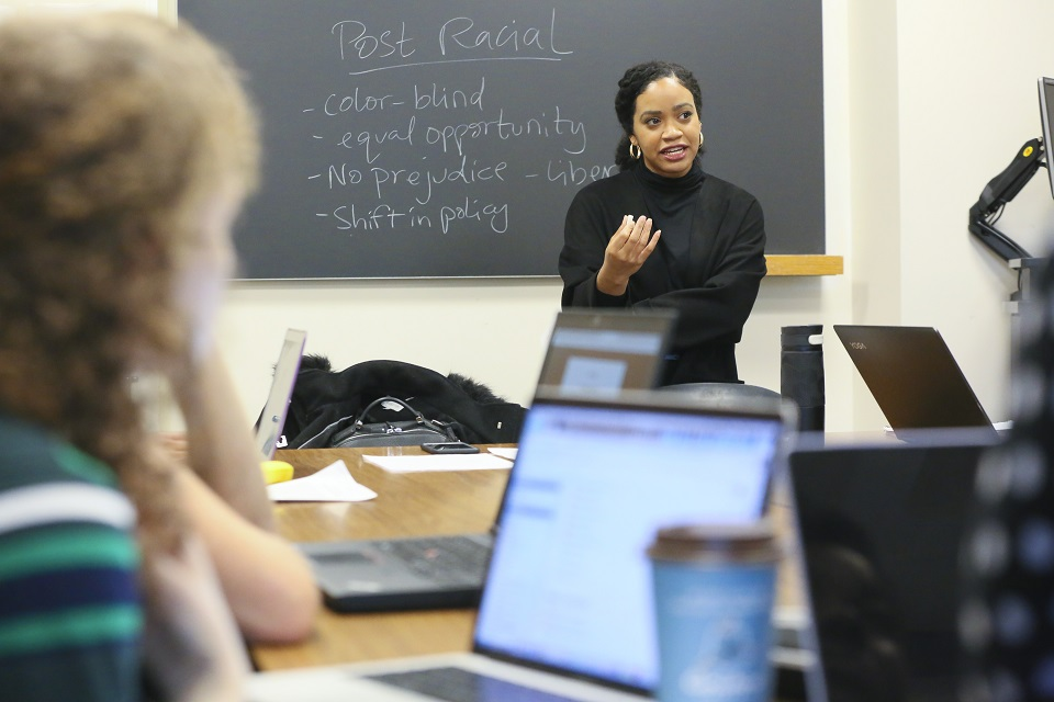 Professor Amber Spry teaching in a classroom