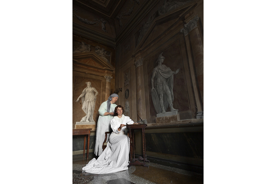 image of two women in museum, historical clothing